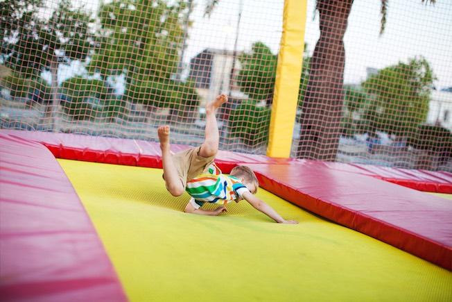boy jumping at a trampoline park