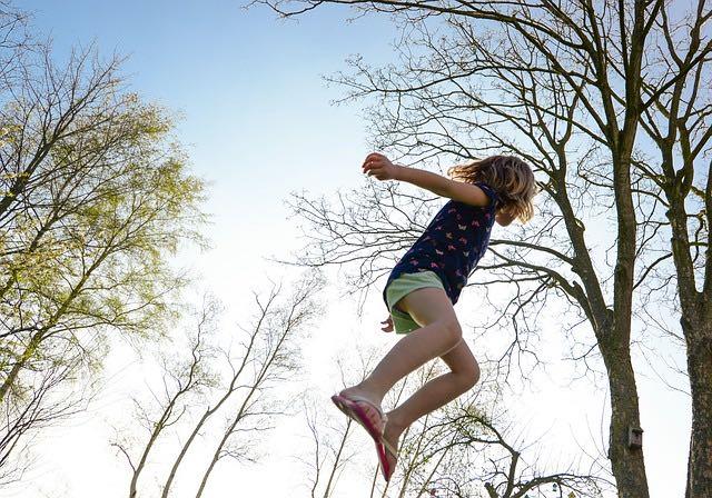 girl in mid-air jump