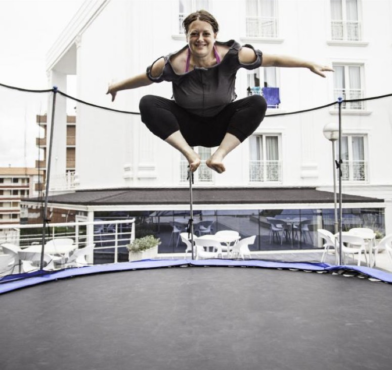 Woman exercising on trampoline