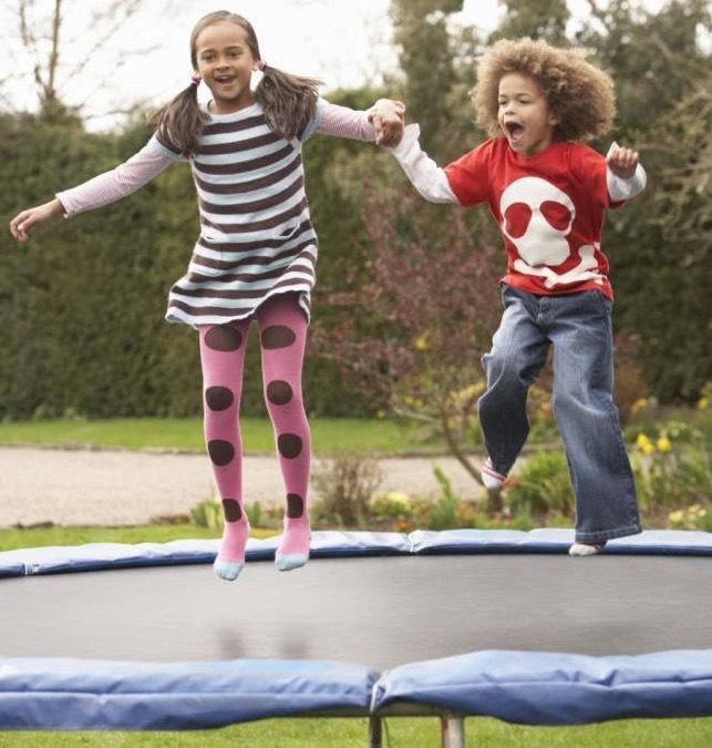 happy kids on trampoline